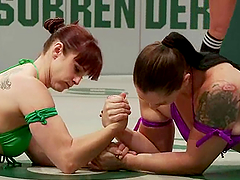 Bella Rossi and Mistress Kara play with a strapon in tatami