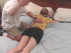 Short-haired cutie Zoe gets fiercely spanked by some guy in a bedroom