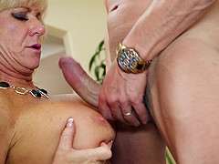 Vivacious granny with great juggs sucking a stranger's cock and balls